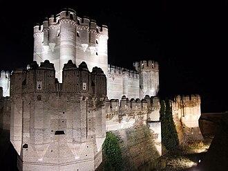 Coca, Segovia - The 15th century Coca Castle at night.
