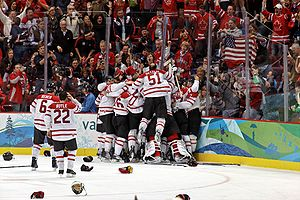 The Canadian men's ice hockey team celebrates ...