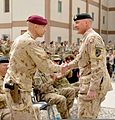 Canadian Army Brig. Gen. Wayne Eyre, left, the incoming commander of NATO Training Mission-Afghanistan (NTM-A), shakes hands with Maj. Gen. Dean Milner, the NTM-A outgoing commander, during a transfer 140310-N-ZZ999-002.jpg
