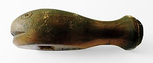 Whistle - Carved whalebone whistle dated 1821. 8 cm long.