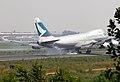 Cathay Pacific Boeing 747-467F(ER) B-HUP Smokey Landing (8226826680).jpg