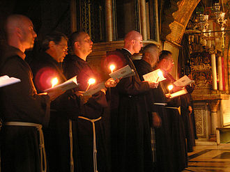 Order of the Holy Sepulchre - Contemporary Franciscan monks during the procession on the Calvary in the Church of the Holy Sepulchre (2006).