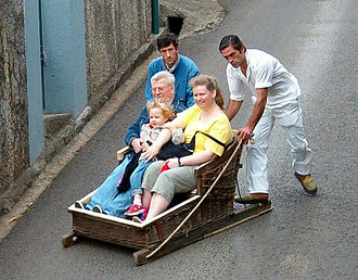 Monte (Funchal) - The toboggan drivers do not always wear the uniform, but ferry tourists downhill at high speeds