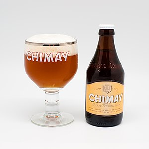 Beer in Belgium - A Chimay tripel beer with its branded glass