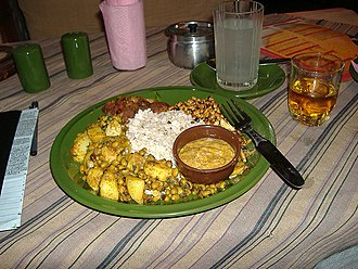 Newa cuisine - A typical snack of beaten rice, vegetables, roasted meat and other sides