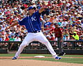 Chris Young delivers a pitch (25087264973).jpg