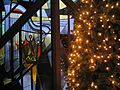 Christmas tree by stained glass windows.JPG