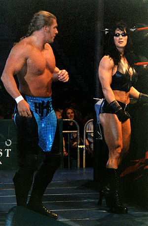 D-Generation X - Chyna (right), acted as an enforcer for Triple H (left) and Michaels in 1997, then remained allied with the larger incarnation of the stable until 1999