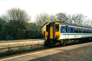British Rail brand names - A First North Western Class 156 at Romiley Junction station, near Manchester in the year 2001. It is in its former 'Network North Western' Regional Railways livery.