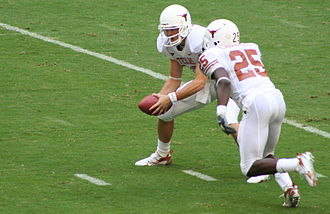 Texas Longhorns football -  Colt McCoy hands the ball to Jamaal Charles.