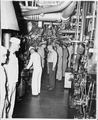 Commander N. V. King shows President Harry S. Truman the engineering room of the U. S. S. Augusta as the President... - NARA - 198684.tif