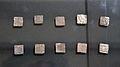 Conjunt de deu dírhams quadrats de plata d'època almohade, cova del Barranc del Migdia.JPG