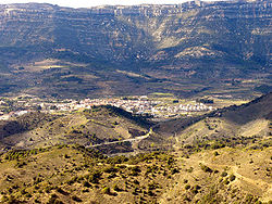 The town with the massive escarpments in the background