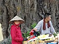 Couple at Market Stall - Old Quarter - Hanoi - Vietnam (48071367577).jpg