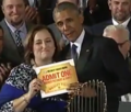 Cubs visit to the White House, Laura Ricketts presents Obama with lifetime pass to Wrigley Field (03).png