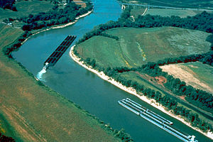 Barge - Multiple barges pushed around a tight bend on the Cumberland River