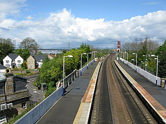 Dalmeny railway station - Dalmeny railway station in 2009. The Forth Bridge can just be seen in the distance.