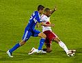 Davy Arnaud vs Thierry Henry 2012-07-28.jpg