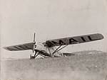 De Havilland DH.80A Puss Moth VH-UPN in field.jpg