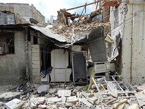 Timeline of the Syrian Civil War (January–April 2012) - Destruction in Bab Dreeb area at Homs after heavy shelling by the Syrian Army.