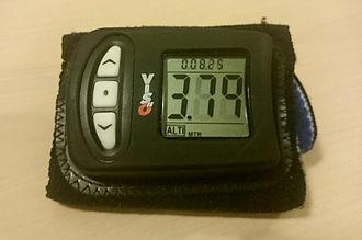 Altimeter - Digital wrist-mounted skydiving altimeter in logbook mode, displaying the last recorded jump profile.