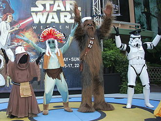 "Village People - Star Wars characters, a Jawa, Greedo, Chewbacca and an Imperial Stormtrooper, assume the roles of the Village People for the ""Y.M.C.A."" dance at a Disney ""Star Wars Weekends"" event in 2007."