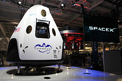 The Dragon V2 stands on a stage inside SpaceX headquarters in Hawthorne, Calif., after its unveiling.