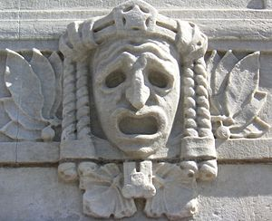 Suffering - Tragic mask on the façade of the Royal Dramatic Theatre in Stockholm, Sweden.