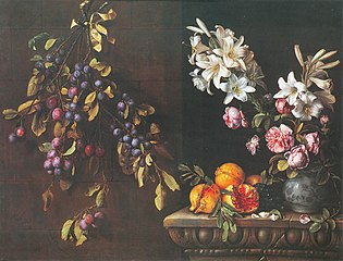 Still life with plum branch hanging from a wall, pomegrenates and vase of lilies on a carved end table