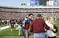 During the pre-game honors, Quarterback Drew Bledsoe of the Buffalo Bills football team, meets with family members of deceased Iraqi war personnel at Niagara Falls, New York, on September 7th, 2003 030907-F-KW623-004.jpg