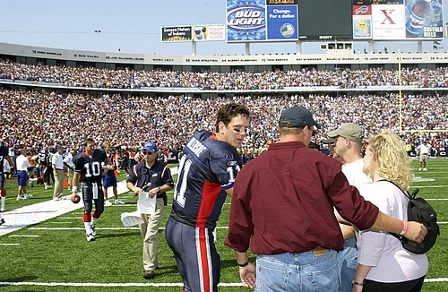 Bledsoe greeting family members of fallen Iraq War personnel before a game with the Bills in 2003 During the pre-game honors, Quarterback Drew Bledsoe of the Buffalo Bills football team, meets with family members of deceased Iraqi war personnel at Niagara Falls, New York, on September 7th, 2003 030907-F-KW623-004.jpg