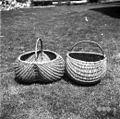 """Dve """"procajni"""" (pleteni košari) za krompir na njivi pobirat - pri Brlogarju, Male Lašče 1960.jpg"""