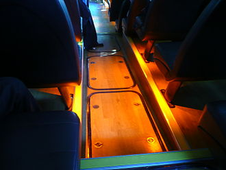 South East Hampshire Bus Rapid Transit - Inside an Eclipse BRT bus showing the downward facing under seat lighting and the wood effect flooring.