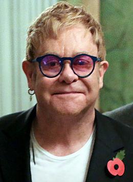 >Elton John