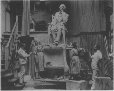 Elwell, right, and a model in his studio with Dickens and Little Nell in 1890
