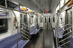 The empty interior of a newer R142A car on the 4 train