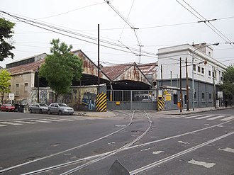 Polvorín Workshop - Exterior view of the workshop. Note tram rails and overhead lines.