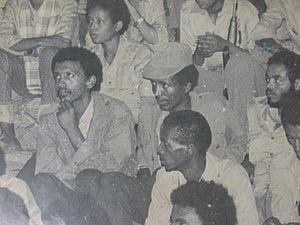 Bereket Simon - Seated in center (with hat) during a political meeting in 1970's. To his left is Meles Zenawi