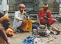 Fakir with a flute and snake India.jpg