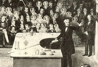 Public lecture - Michael Faraday, nineteenth century scientist and electrician, shown delivering the British Royal Institution's Christmas Lecture for Juveniles during the Institution's Christmas break in 1856.