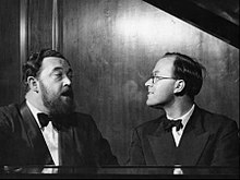 Photo of Flanders and Swann singing at the piano
