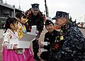 Flickr - Official U.S. Navy Imagery - 7th Fleet Chief of Staff, greets Korean children..jpg
