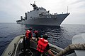 Flickr - Official U.S. Navy Imagery - Boatswain Mate 3rd Class Michael Kenyon prepares to get lowered from the amphibious dock-landing ship USS Gunston Hall..jpg
