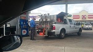 Fuel dispenser - A state petroleum inspector visiting a Mobil station in Port Charlotte, Florida
