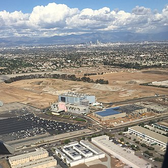 Los Angeles Stadium at Hollywood Park - 2015 aerial view of former racetrack and complex site, with the Downtown Los Angeles skyline in background.