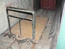 Photo d'une wagonnet posé sur des rails.