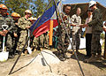From center right, Philippine army Lt. Col. Henry Bellan, U.S. Army Lt. Col. John Garrity, San Narciso Municipality Mayor Peter Lim and U.S. Marine Corps Capt. Benjamin Nichols lower a time capsule containing 130318-N-VN372-073.jpg