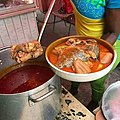 Fufu with tilapia, meat and light soup.jpg