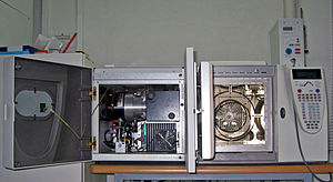 A gas chromatograph (right) directly coupled to a mass spectrometer (left)