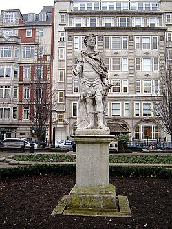 Statue of George II in Golden Square, Soho, London. By John Nost the elder, this was erected in 1753, but had actually been made 33 years previously for the Duke of Chandos. It is badly corroded (it has been suggested that this is due to over-zealous cleaning) and the right hand is damaged. The only other public statue of this king in London is at the Royal Naval College in Greenwich. (January 2006)